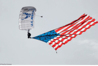A parachutist carries the American flag while dropping into Falcon Stadium before the first half of an NCAA college football game September 1 at the US Air Force Academy.: IR FORG  AP Photo/David Zalubowski A parachutist carries the American flag while dropping into Falcon Stadium before the first half of an NCAA college football game September 1 at the US Air Force Academy.