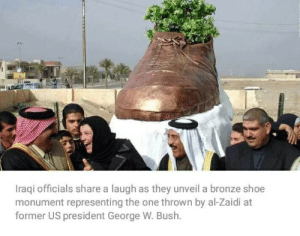 Post feet pics: Iraqi officials share a laugh as they unveil a bronze shoe  monument representing the one thrown by al-Zaidi at  former US president George W. Bush. Post feet pics