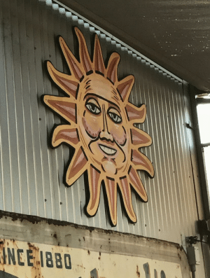 Is it me, or does this sun decoration look like it's about to steal the Declaration of Independence.: Is it me, or does this sun decoration look like it's about to steal the Declaration of Independence.