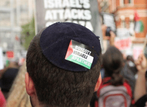 "pxlestine:  A British Jewish man stuck a ""Boycott Israel"" sticker to his Kippah in solidarity with Palestinians.   This is very important. Americans especially (but others are guilty) have to realize that being against or criticizing Israel IS NOT ANTI-SEMITIC. Caring about human rights is not anti-semitic. A criticism of Israel is not a criticism of all Jewish people. Many Jewish people (especially in Tel-Aviv and NYC) are EXTREMELY critical of Israel. Get it through your head. Criticism of something doesn't always mean you hate something or you hate the people you are criticizing. : ISRAEL  ATTACKS  BOYCOTT  ISRAELI  APARTHEID  Palesties wpalestcanpigr. pxlestine:  A British Jewish man stuck a ""Boycott Israel"" sticker to his Kippah in solidarity with Palestinians.   This is very important. Americans especially (but others are guilty) have to realize that being against or criticizing Israel IS NOT ANTI-SEMITIC. Caring about human rights is not anti-semitic. A criticism of Israel is not a criticism of all Jewish people. Many Jewish people (especially in Tel-Aviv and NYC) are EXTREMELY critical of Israel. Get it through your head. Criticism of something doesn't always mean you hate something or you hate the people you are criticizing."