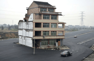jakemorph: furtho: In the middle of a new highway, a house owned by an elderly couple who refused to sign an agreement allowing it to be demolished, Wenling, China, 2012 (via here) : jakemorph: furtho: In the middle of a new highway, a house owned by an elderly couple who refused to sign an agreement allowing it to be demolished, Wenling, China, 2012 (via here)