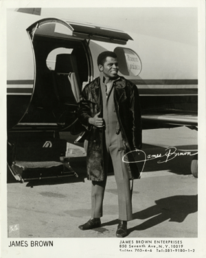 """detroitlib:    James Brown(May 3, 1933 – December 25, 2006)    View of singer James Brown standing in front of airplane. Printed on front: """"James Brown. James Brown Enterprises, 850 Seventh Ave, N.Y. 10019, Suites 703-4-6, tel: 581-9180-1-2. Mr. Mo."""" Signature of James Brown printed on front.  Courtesy of the E. Azalia Hackley Collection of African Americans in the Performing Arts, Detroit Public Library: JAMES BROWN  JAMES BROWN ENTERPRISES  850 Seventh Ave, N. Y. 10019  s""""ites 7 3-4-6 Tel:581-9180-1_2 detroitlib:    James Brown(May 3, 1933 – December 25, 2006)    View of singer James Brown standing in front of airplane. Printed on front: """"James Brown. James Brown Enterprises, 850 Seventh Ave, N.Y. 10019, Suites 703-4-6, tel: 581-9180-1-2. Mr. Mo."""" Signature of James Brown printed on front.  Courtesy of the E. Azalia Hackley Collection of African Americans in the Performing Arts, Detroit Public Library"""