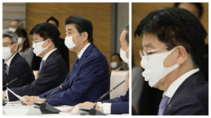 Japanese media keep focusing on PM Abe's small mask, yet there's this guy beside him.: Japanese media keep focusing on PM Abe's small mask, yet there's this guy beside him.