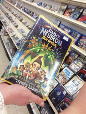 Children, Funny, and Jimmy Neutron: Boy Genius: JIMMY  NEUIRON  BOY GENIUS  JUMPIN  JIMMY NEUTRON: BOY GENIUS IS  CLEVER&FUNNY..  er  Nt  gROOM  GETA thepurdypurdy:  THIS PHOTO WAS TAKEN LAST WEEK AT MY LOCAL KMART. YES, THAT IS A SEALED VHS TAPE OF JIMMY NEUTRON THE MOVIE, IN 2014, AT KMART, SITTING NEXT TO DVDS AND BLU-RAYS, PRICED AT $8.99  To give perspective, this film was released on VHS in 2002 and has been sitting unopened in a Kmart store for 12 years, longer than children now in middle school.  Plain proof that no one does inventory or gives a shit at any Kmart anywhere. Someone could probably live in Kmart and have no one notice.