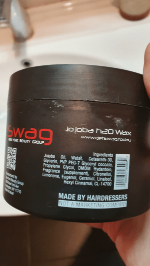 New York, Hair, and Today: Jo joba h20 Wax  www.getswag.today  SWao  MEW YORK 3EAUTY GROUP  Ingredients  Jojoba Oil, Watek Ceteareth-30,  Glycerin, PVP PEG-7 Glyceryl cocoate  Propylene Glycol, DMDM Hydantoin,  Fragrance (supplement), Citronellol,  Limonene, Eugenol, Geraniol, Linalool,  Hexyl Cinnamal, CL-14700  Manufactured by  lewyYork Beauty Group  38A New York Ave  otingon,NY 11743  Mate in Israe  MADE BY HAIRDRESSERS  NOT A MARKETING COMPANY  6  00080 08003 How many marketing companies do you know that make hair wax?