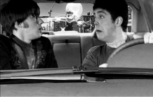 John Lennon and Paul McCartney speed away from a crazy fan (1967): John Lennon and Paul McCartney speed away from a crazy fan (1967)