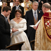 At-St, Memes, and Queen Elizabeth: Jonathan Brady, Pool via AP Jack Brooksbank places the ring on the finger of Britain's Princess Eugenie of York, the granddaughter of Queen Elizabeth II, during their wedding ceremony at St George's Chapel, Windsor Castle.