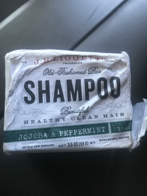 England, Hair, and Old: JRLIGGETTE  U.S.  TRADEMARK  Old  -Tashioned Bar  SHAMPOO  Beadifel  HEALTHY CLE AN HAIR  Aeswiuter  wivivh  8AR N9  2.R.L. SHAMPOO FORMULA  JOJOBA & PEPPERMINT G  BYGONE ERA RECIPE  NET 3.5 02 (99 G) wT.  AN OLD NEW ENGLAND  9 I got a bar of shampoo