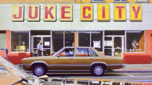 Due to the more saturated letters in CITY it seems this establishment in 'Mind Hunter' S2E4 was previously named something else, perhaps JUKE TOWN, before it switched owners.: JUKE CITY  TECOMIMILE TO  HELP! 0  STOP  ORNS AUKS  DTHER  519  1ONINE Due to the more saturated letters in CITY it seems this establishment in 'Mind Hunter' S2E4 was previously named something else, perhaps JUKE TOWN, before it switched owners.