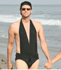 Just a Picture of Jim Carrey, Staring Down a Paparazzi Photographer, in His Girlfriends 1 Piece Bathing Suit