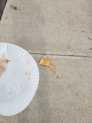 Just walked out of the pizza shop on my way to the park. Pizza slices weren't cut properly and it slid off my plate when I was trying to separate them.: Just walked out of the pizza shop on my way to the park. Pizza slices weren't cut properly and it slid off my plate when I was trying to separate them.