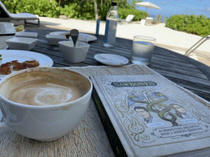 Memes, Coffee, and Vacation: justin McElroy  Dr.Sydnee Meenn  the HORRIFYING HILARIOUS  lustrations by The @Sawbones is a SWEET, HILARIOUS vacation read. And now I'm remembering the coffee I drank with it...🤤 https://t.co/6OmumHFGEx