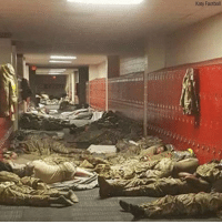 """Football, Memes, and School: Katy Football """"These are the real heroes."""" The Katy High School football team tweeted this photo showing servicemembers resting in the high school's hallway while on a break from HurricaneHarvey relief efforts."""