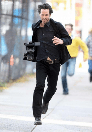 Keanu Reeves after stealing a camera from the paparazzi: Keanu Reeves after stealing a camera from the paparazzi