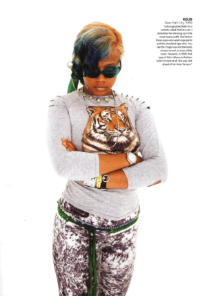 "80s: KELIS  New York City, 1999  ""I photographed Kelis for a  website called Platform.net. I  remember her showing up in the  most insane outfit. She had on  these quasi-acid-wash-type pants  and this shredded tiger shirt. You  see the image now and she looks  almost normal, or even a little  ironic. However, in 1999, that  type of '80s-influenced fashion  wasn't in style at all. She was a bit  ahead of her time, for sure."""