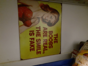 Poster in my sister's room who complained about having small tits: Ki  HYPER  TOU  E 31  TEXA  GUCK  3.5  THE  BOOBS  ARE REAL,  THE SMILE  IS FAKE Poster in my sister's room who complained about having small tits