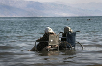 killing-the-prophet: Elderly Palestinian women sit in wheelchairs as they enjoy the waters of the northern part of the Dead Sea, in the West Bank, on October 2, 2008.Menahem Kahana: killing-the-prophet: Elderly Palestinian women sit in wheelchairs as they enjoy the waters of the northern part of the Dead Sea, in the West Bank, on October 2, 2008.Menahem Kahana