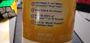 What even happened to this text: Kills Staph,E.coli; MRSA,  Salmonella Strep Kleb $  Kills Cold&Flu Viruses'  Ki 99.999% of  Ba reria* $$5 in 10 Seconds  Great for Wood* Granite*  & Stainless Steel  RE  A 2 PC18.5%)  de0.184%  KEEP OUT OF REAGH  CAUTION  78 WET WIPES  1 LB 4.5 0Z (581 g)  0 184%  632  08.000 What even happened to this text