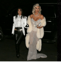 Kim and Kourtney Kardashian took the cake for costumes Saturday night in Bel Air with Kim as Madonna and Kourtney as Michael Jackson. halloween michaeljackson madonna kimkardashian kourtneykardashian tmz: Kim and Kourtney Kardashian took the cake for costumes Saturday night in Bel Air with Kim as Madonna and Kourtney as Michael Jackson. halloween michaeljackson madonna kimkardashian kourtneykardashian tmz
