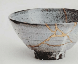 Kintsugi (golden joinery) is the Japanese art of repairing broken pottery by mending the areas of breakage with lacquer dusted or mixed with powdered gold, silver, or platinum. It's philosophy is to embrace the flaw rather than to disguise it.: Kintsugi (golden joinery) is the Japanese art of repairing broken pottery by mending the areas of breakage with lacquer dusted or mixed with powdered gold, silver, or platinum. It's philosophy is to embrace the flaw rather than to disguise it.