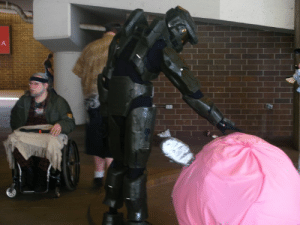 Kirby wanted to hold Master Chief's hand but instead he got head pats. Been almost 10 years since seeing this cute moment and it still makes me smile.: Kirby wanted to hold Master Chief's hand but instead he got head pats. Been almost 10 years since seeing this cute moment and it still makes me smile.
