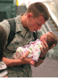 First time for this soldier to see his 3 week old daughter. He is looking at her like she is made of gold.: KOHL First time for this soldier to see his 3 week old daughter. He is looking at her like she is made of gold.