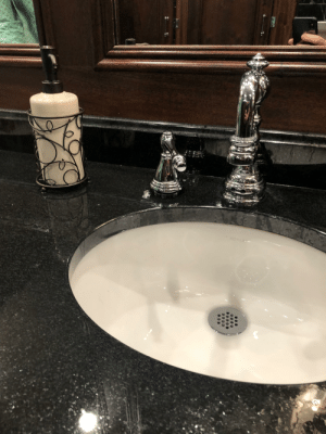 Kohler, Silver, and Soap: KOHLER That silver handle next to the faucet and soap dispenser...it's a soap dispenser.
