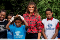 Children, Club, and Girls: KYS & GIRLS CLUB  GREATER WASHINGTON  GIRLS CLUB  ATER WASHIN  FBR BRANCH  ON  t THEARC  OF  FBER WASHINGTON  NCH at THEARC  (AP Photo/Andrew Harnik) First Lady Melania Trump poses with children with the Boys and Girls Club of Washington in the @WhiteHouse Kitchen Garden.