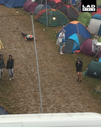 Dank, Bible, and Rain: LAD  BIBLE A little bit of rain never ruined anyone's festival 😂🌧️⛺