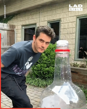 The 'Bottle Cap Challenge' is a new trend that is sweeping the internet. Think you could nail this? 🍾: LAD  BIBLE  [JOHNMAYER] The 'Bottle Cap Challenge' is a new trend that is sweeping the internet. Think you could nail this? 🍾