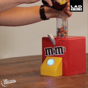 Dank, Life, and Bible: LAD  BIBLE  l&ms  THE  PRACTICAL  ENGINEER This device fires M&Ms into your mouth. I need this in my life 😂👏  The practical engineer
