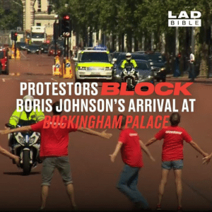 Earlier this afternoon, climate change activists blocked Boris Johnson's path as he made his way to Buckingham Palace ahead of becoming Prime Minister...: LAD  BIBLE  PROTESTORSBLOCK  BORIS JOHNSON'S ARRIVAL AT  B-UCKINGHAM PALACE Earlier this afternoon, climate change activists blocked Boris Johnson's path as he made his way to Buckingham Palace ahead of becoming Prime Minister...