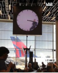 This clock in Amsterdam's Schiphol Airport is amazing 😍: LAD  BIBLE This clock in Amsterdam's Schiphol Airport is amazing 😍