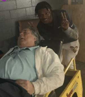 Lamar Jackson of the Ravens sneaking up on an old dude.: Lamar Jackson of the Ravens sneaking up on an old dude.