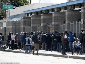 LA's Skid Row has grown in population during the Pandemic who continue to crowd the mission entrance: LA's Skid Row has grown in population during the Pandemic who continue to crowd the mission entrance