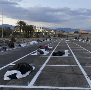 Las Vegas puts homeless people in parking lots while most of the city's hotels are completely empty. For some reason, this photo is just summing up for me everything that is wrong with this country and its response to this crisis. #Capitalism: Las Vegas puts homeless people in parking lots while most of the city's hotels are completely empty. For some reason, this photo is just summing up for me everything that is wrong with this country and its response to this crisis. #Capitalism