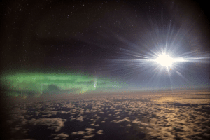 Image, Moon, and Stars: Last night's view from onboard SOFIA at 43,000ft. Aurora, Moon, Stars & Clouds. Currently on deployment to Christchurch, NZ to obtain high quality infrared astronomy data! Image Credit: Ian Griffin.