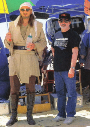 "laughoutloud-club:  You may be cool but you'll never be ""Liam Neeson wearing sunglasses and a bandana while holding a multicolored umbrella in a master jedi outfit beside George Lucas"" cool.: laughoutloud-club:  You may be cool but you'll never be ""Liam Neeson wearing sunglasses and a bandana while holding a multicolored umbrella in a master jedi outfit beside George Lucas"" cool."