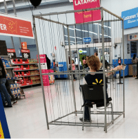My Walmart put an employee in a cage to ask for donations to be let out: LAYAWA  here  ER  Enter  88- My Walmart put an employee in a cage to ask for donations to be let out