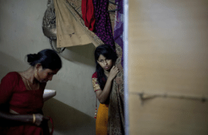 letswakeupworld:  Fifteen-year-old Nasoin Akhter looks out of a dressing room at a beauty parlor on the day of her wedding to a thirty-two-year-old man in Manikganj, Bangladesh. (Photo Credit: Allison Joyce): letswakeupworld:  Fifteen-year-old Nasoin Akhter looks out of a dressing room at a beauty parlor on the day of her wedding to a thirty-two-year-old man in Manikganj, Bangladesh. (Photo Credit: Allison Joyce)
