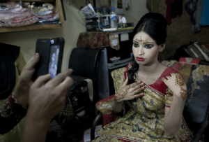 letswakeupworld:  Fifteen-year-old Nasoin Akhter poses in a beauty parlor on the day of her wedding to a thirty-two-year-old man in Manikganj, Bangladesh. (Photo Credit: Allison Joyce): letswakeupworld:  Fifteen-year-old Nasoin Akhter poses in a beauty parlor on the day of her wedding to a thirty-two-year-old man in Manikganj, Bangladesh. (Photo Credit: Allison Joyce)