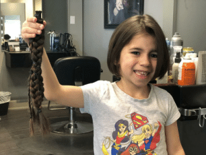 "My 6 year old daughter let her hair grow long so she could cut it and donate it this is her right after the hair cut. She's super proud to be able to help someone ""with no hair feel beautiful"".: LIPPER My 6 year old daughter let her hair grow long so she could cut it and donate it this is her right after the hair cut. She's super proud to be able to help someone ""with no hair feel beautiful""."