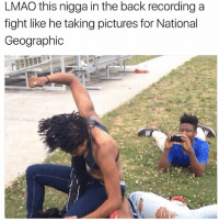 Lmao, Memes, and Savage: LMAO this nigga in the back recording a  fight like he taking pictures for National  Geographic @yourmomsatonmyface is a straight savage 🤣🔥
