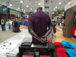 Local sports store has the black mannequins already in the handcuff position.: Local sports store has the black mannequins already in the handcuff position.