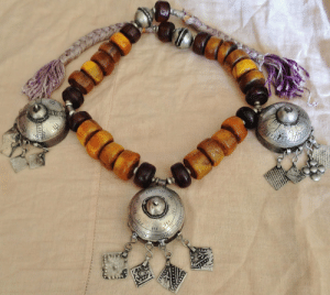 Lol, Tumblr, and Blog: lol-coaster:    Berber Tribal Necklace with 3 Amulet boxes   Faux Amber-Resin Beads Moroccan SaharaTotal Length Necklace: 80 cm with soft lila cord