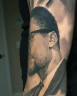 "Malcolm X, Obama, and Rosa Parks: Lonzo's new sleeve features:  ➖ MLK ➖ Rosa Parks ➖ Jackie Robinson ➖ Malcolm X ➖ Harriet Tubman ➖ Barack Obama  ""The Marathon Continues"" at the top of the arm 🏁  (via stevebutchertattoos/IG)"