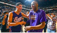 """Devin Booker looks a lot like the Mini Mamba...   Kobe Bryant and Devin...   - Both had fathers that played in the NBA - Both were the youngest players in their Draft - Both were drafted with the 13th Pick  - Both are 6 foot 6 Shooting Guards  - Both have had 60+ Point scoring games  Kobe was drafted in 1996. Devin Booker was born in 1996.  Not only that, Devin Booker signed with Nike Basketball because of his love for the Mamba, and even wears Kobe's on court.   And to get even weirder. Exactly 1 year ago, the Phoenix Suns played the LA Lakers and Kobe Bryant signed a pair of his game work Kobe 11's and wrote """"Be Legendary"""" on them.   1 year later, Devin Booker became the youngest player to ever drop 70 points in a game. #MambaMentality: LOS  SKETBALL Devin Booker looks a lot like the Mini Mamba...   Kobe Bryant and Devin...   - Both had fathers that played in the NBA - Both were the youngest players in their Draft - Both were drafted with the 13th Pick  - Both are 6 foot 6 Shooting Guards  - Both have had 60+ Point scoring games  Kobe was drafted in 1996. Devin Booker was born in 1996.  Not only that, Devin Booker signed with Nike Basketball because of his love for the Mamba, and even wears Kobe's on court.   And to get even weirder. Exactly 1 year ago, the Phoenix Suns played the LA Lakers and Kobe Bryant signed a pair of his game work Kobe 11's and wrote """"Be Legendary"""" on them.   1 year later, Devin Booker became the youngest player to ever drop 70 points in a game. #MambaMentality"""
