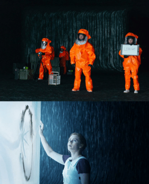 In the movie Arrival, Louise has to take off her hazard suit in order to communicate with the aliens better. The orange color of the suit is a reference to then presidential nominee Donald Trump who is a notoriously shitty communicator.: LOUISE In the movie Arrival, Louise has to take off her hazard suit in order to communicate with the aliens better. The orange color of the suit is a reference to then presidential nominee Donald Trump who is a notoriously shitty communicator.