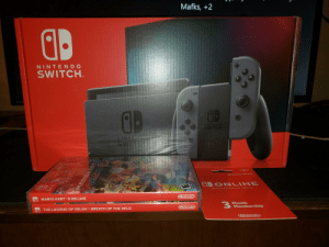 """Merry Christmas to me :): Mafks, +2  NINTENDO  SWITCH.  FIR  NINTENDO  SWITCH  NINTE  SWITC  $799  Nintendo eShop  ODONILINE  Ninte ndo S witch onlime  MARIO KART™ 8 DELUXE  Nintendo  Month  3 Membership  THE LEGEND OF ZELDA"""": BREATH OF THE WILD  Nintendo  Nintendo  SWITCH  EXOTE  EVERYONE  ESRB Merry Christmas to me :)"""