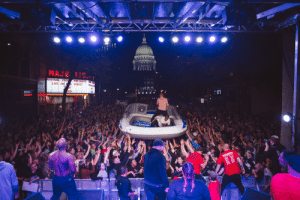 Rough waters in Madison, WI: MAJE TIC  FESTIVAL FOOD  PRESENTS FESIN  LIVE ON G STREET  LIVE ON ING STE  F  OKS  PRE  AdIS  OF'S  FRE GHT  LOADING  2ONE  STAFE  JSERYY  DESCENDENTS  PROF'S  BACK  2019 WORLD TOURAGE  Stoth  SB  KC.  E C  XI Rough waters in Madison, WI